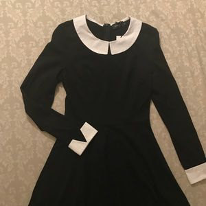 Long sleeve black dress.